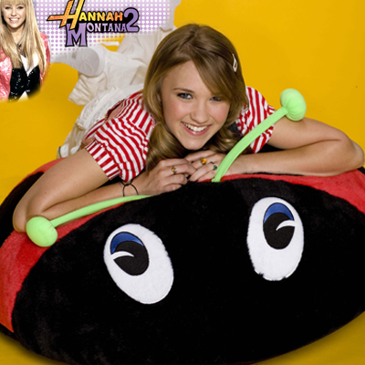illustration of Giant Plush Bean Bag characters, shown here with Miley Cyrus, better known as Hannah Montana in Tiger Beat magazine.